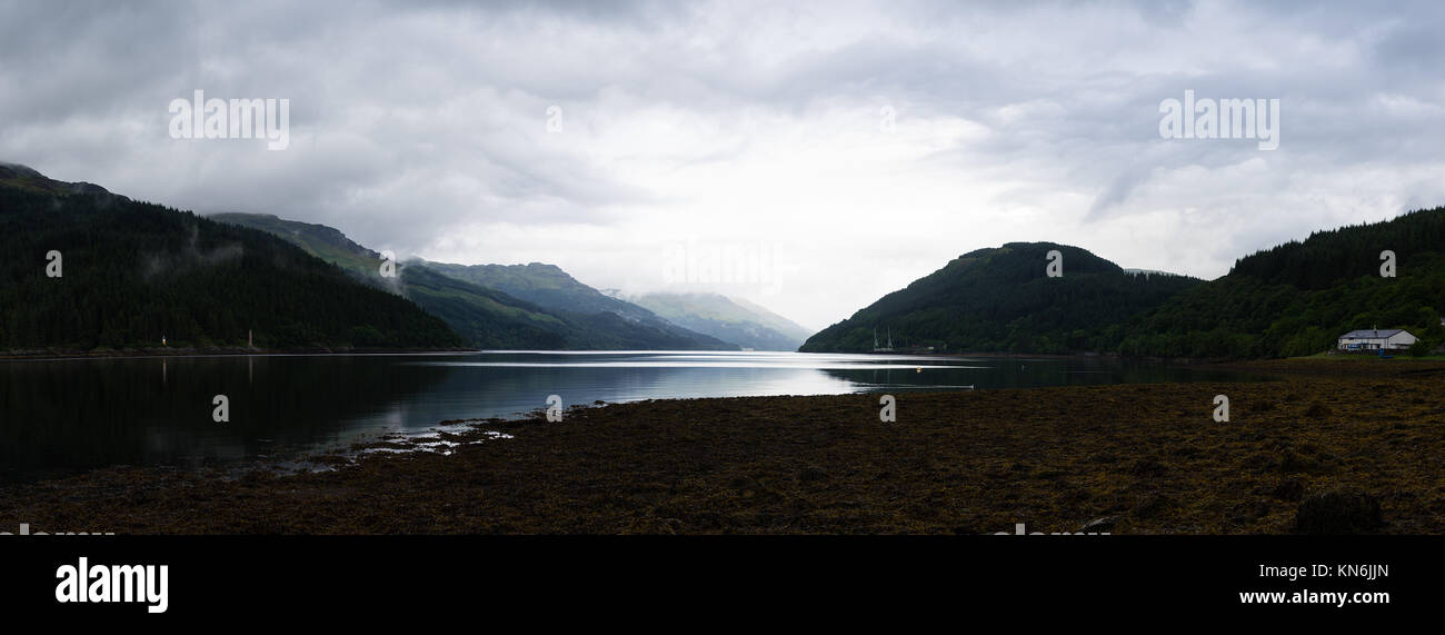 Panoramic view with cloudformation and reflection over Gare Loch Argyll and Bute Scotland - Stock Image
