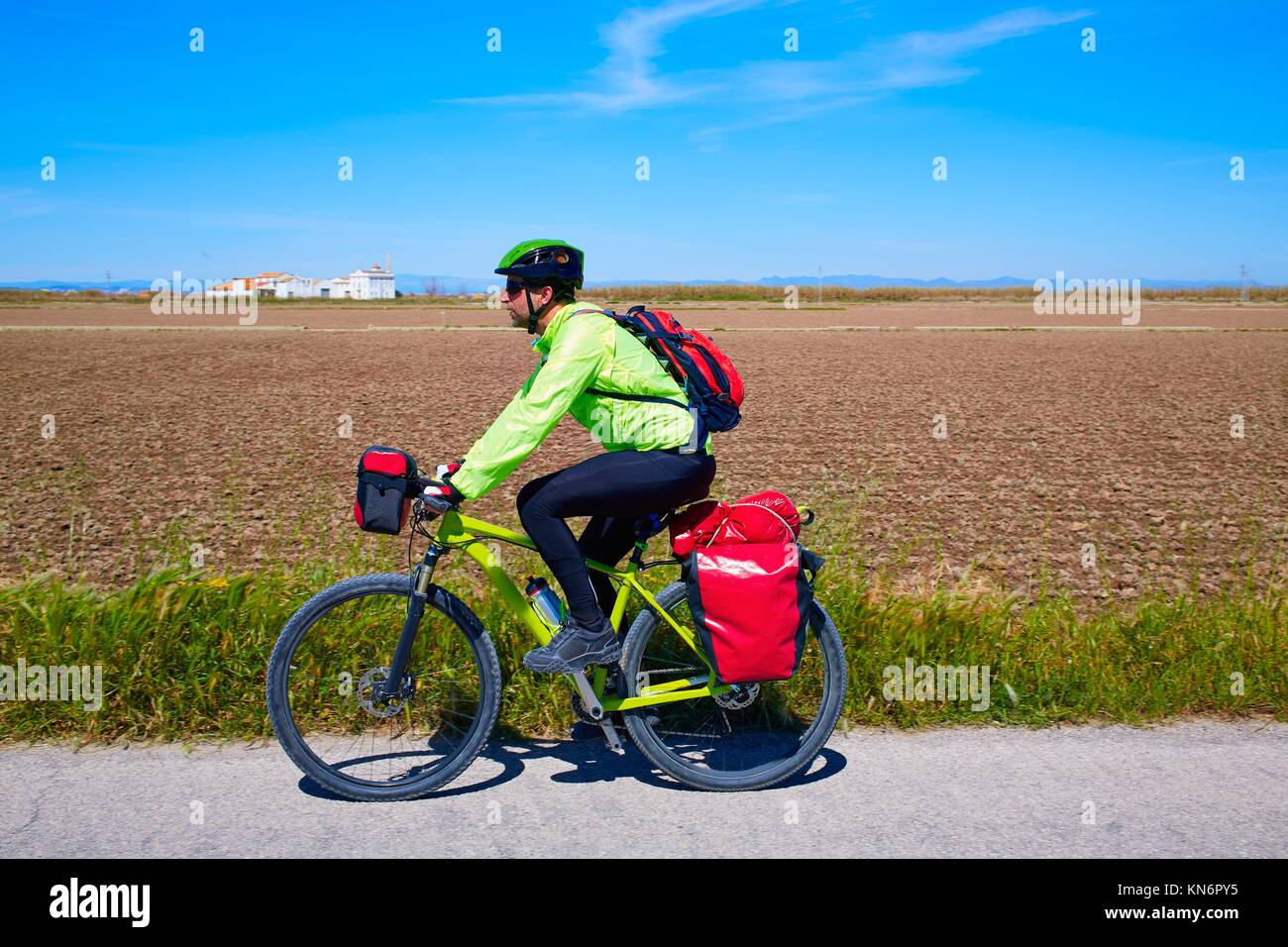 MTB Biker Bicycle touring with pannier racks and saddlebag. - Stock Image