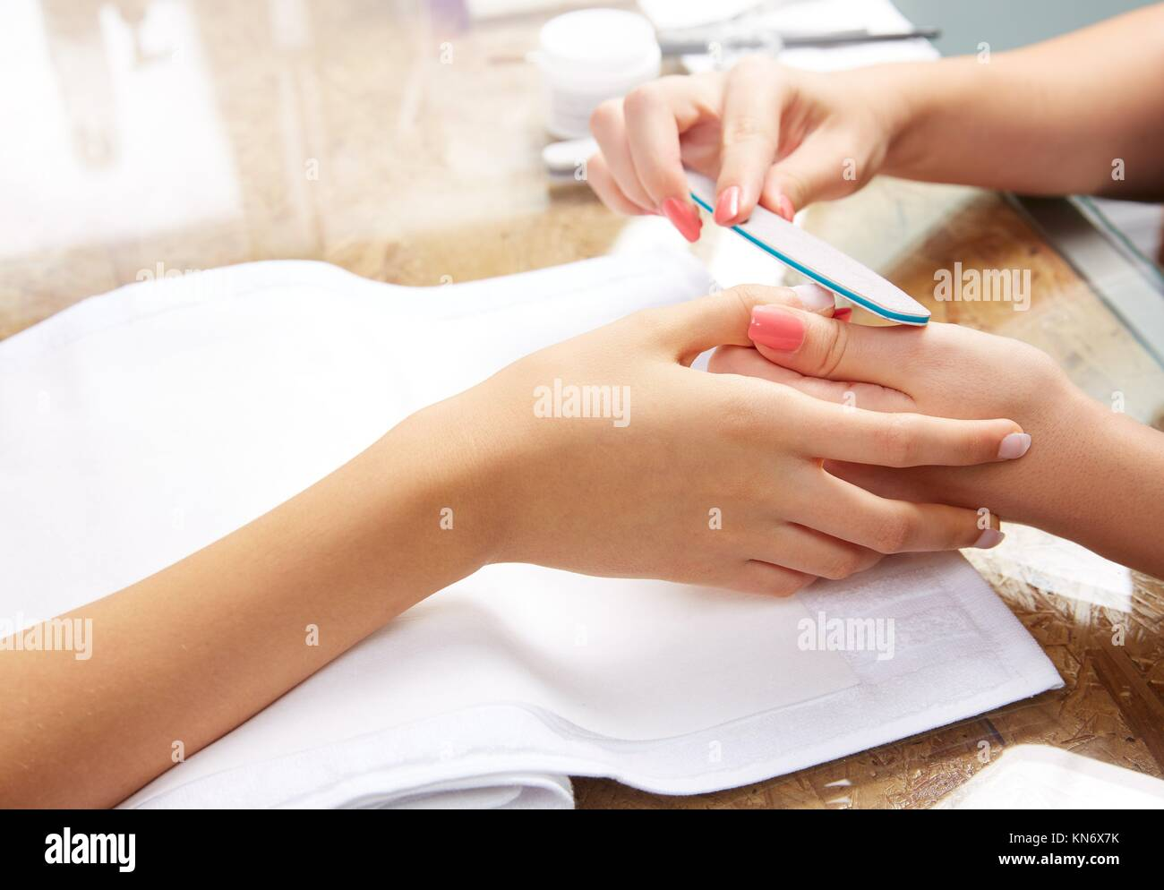 emery polish sandpaper woman nails in Nail Salon. - Stock Image