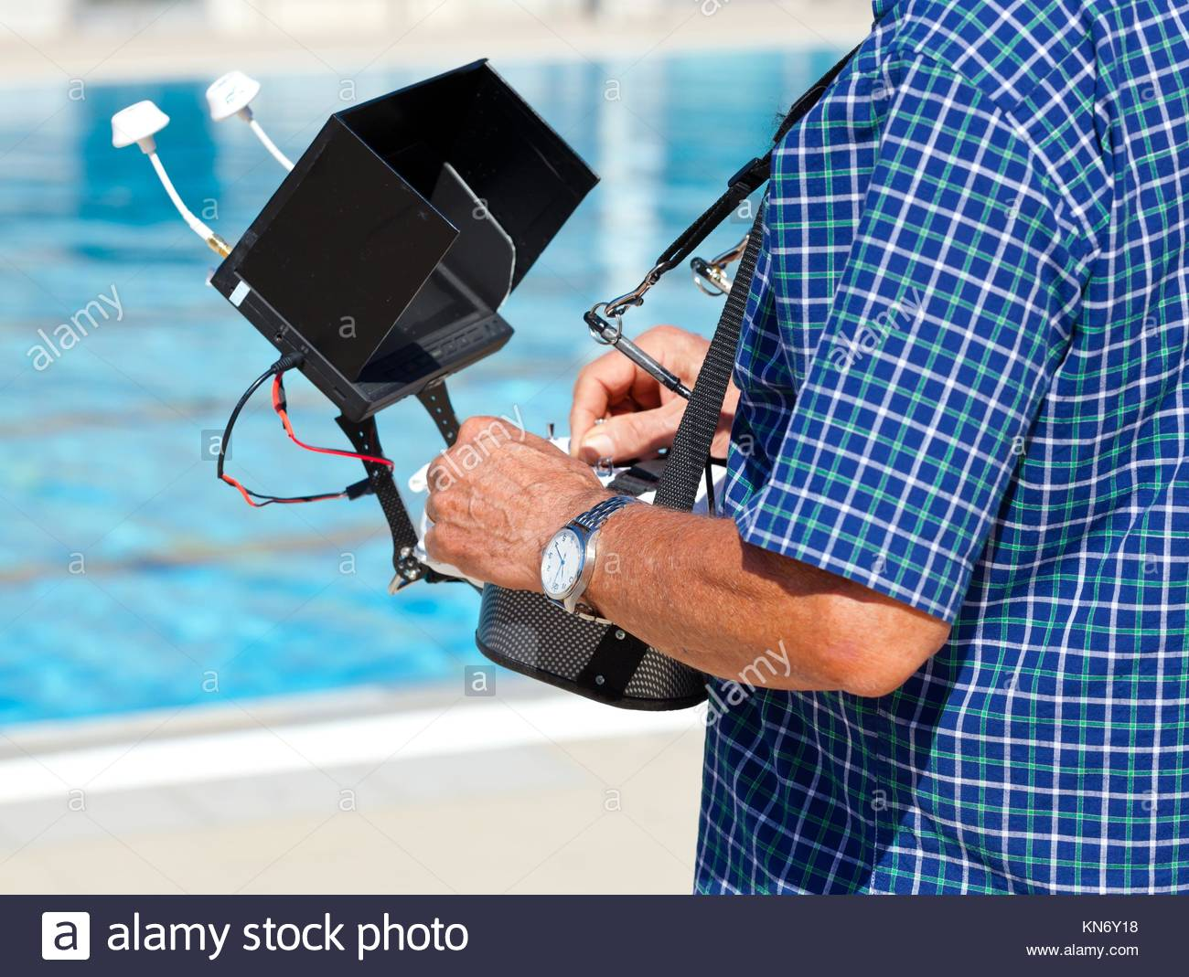 Controlling a remote helicopter drone with LCD preview. - Stock Image
