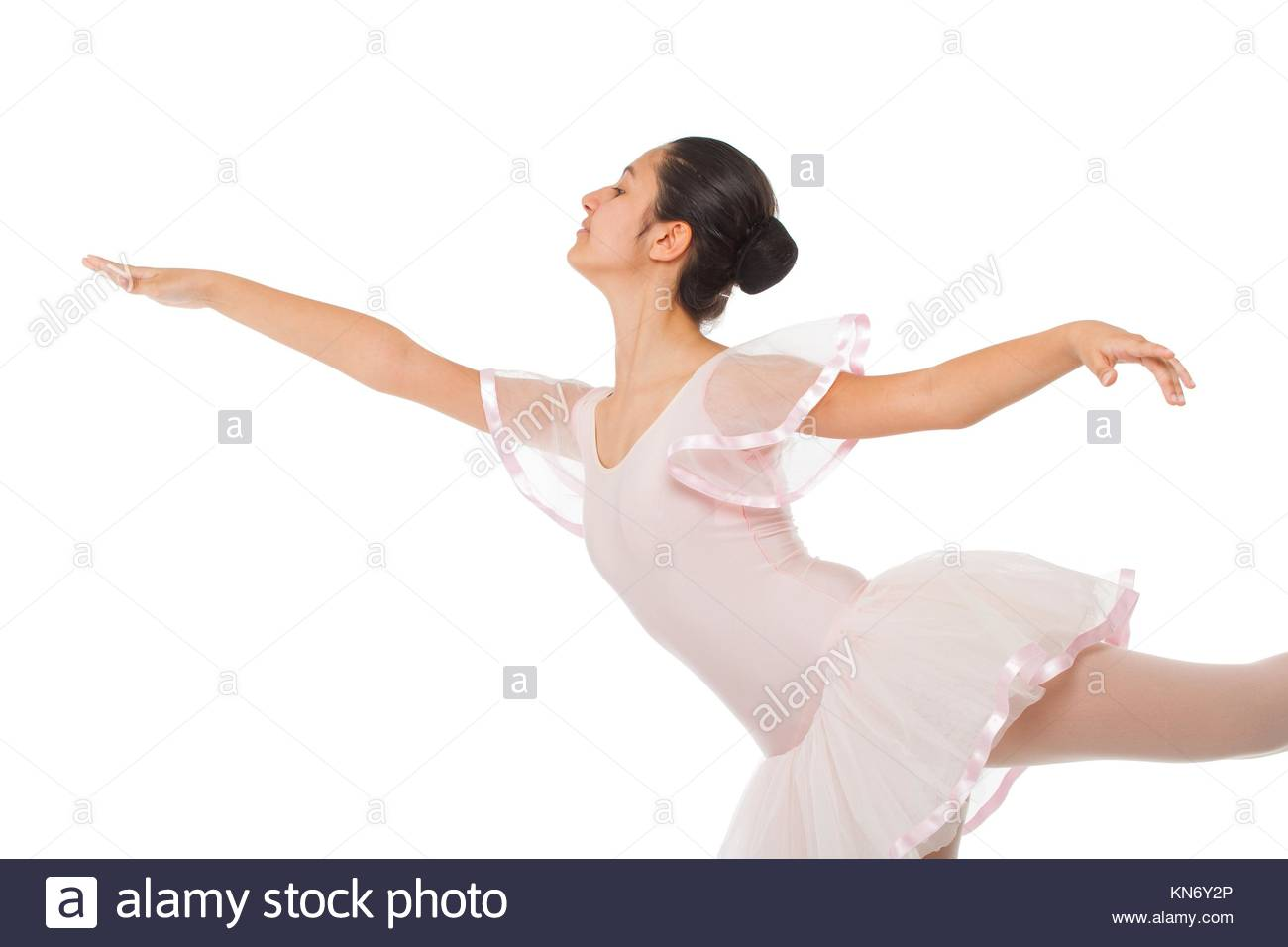 Young ballet dancer isolated on white background. - Stock Image