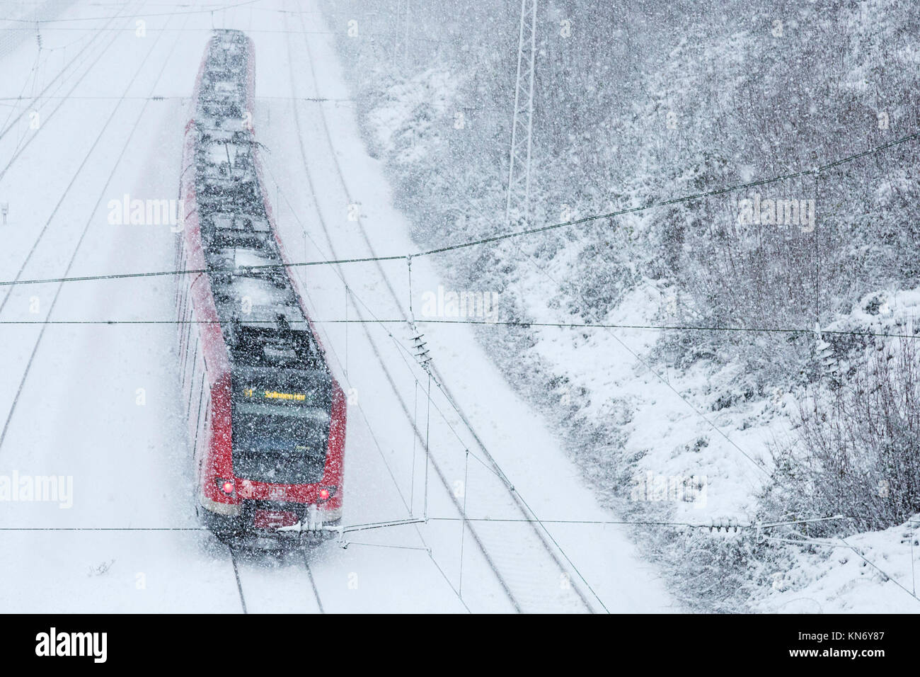 German S-Bahn suburban train in snowy weather, Mülheim an der Ruhr, Germany Stock Photo