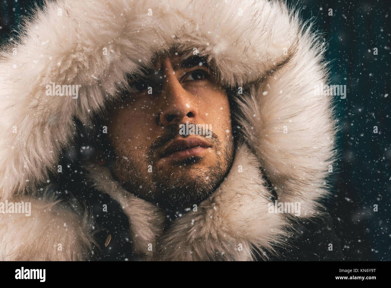 0b23dd0995d Close up portrait of a white man dressed with an eskimo jacket in the snow -