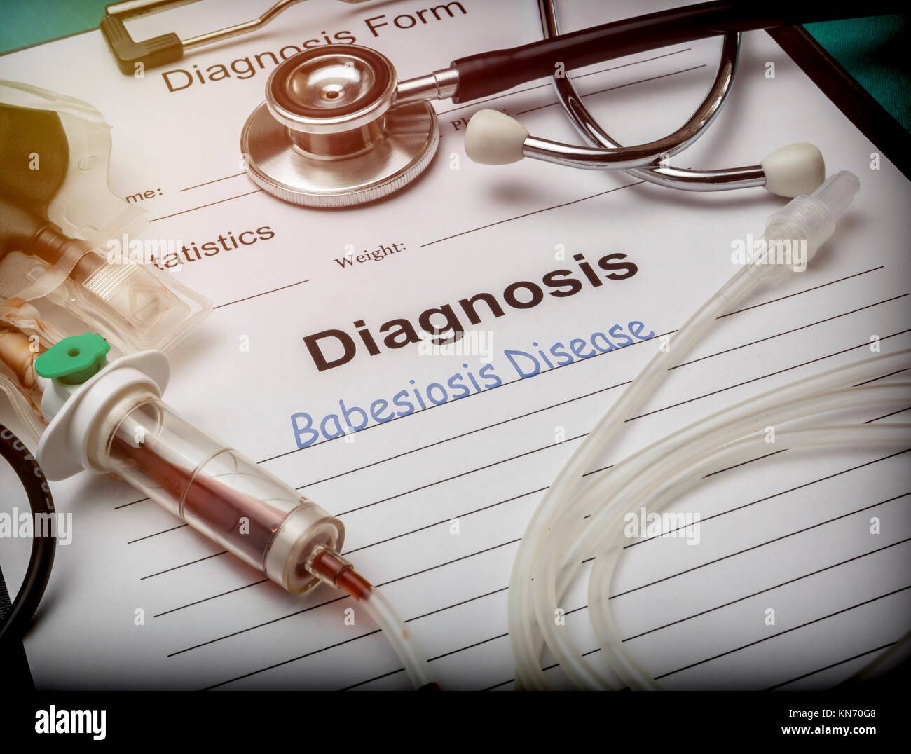 Diagnostic form, babesiosis disease, drip irrigation equipment with traces of blood in a hospital, conceptual image - Stock Image