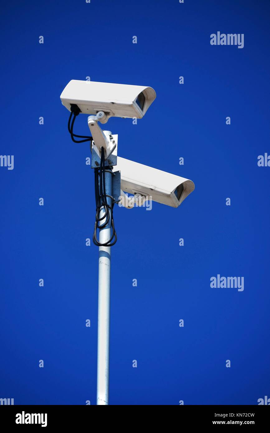 Hi-tech dome type camera over blue sky. - Stock Image