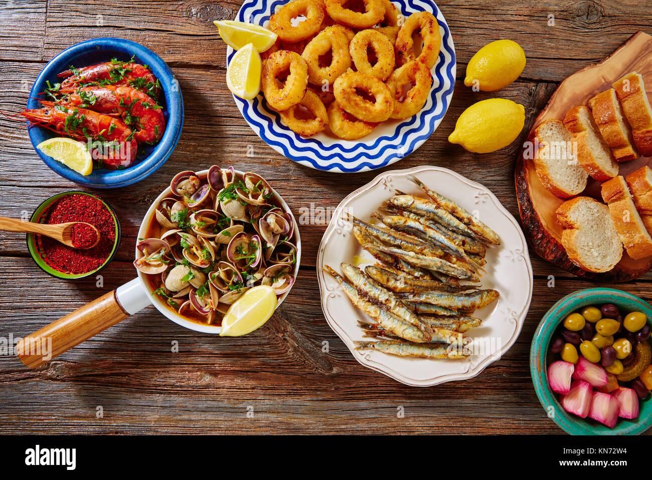 Tapas mix spanish clams olives shrimps calamari romana and fried anchovies fish. - Stock Image