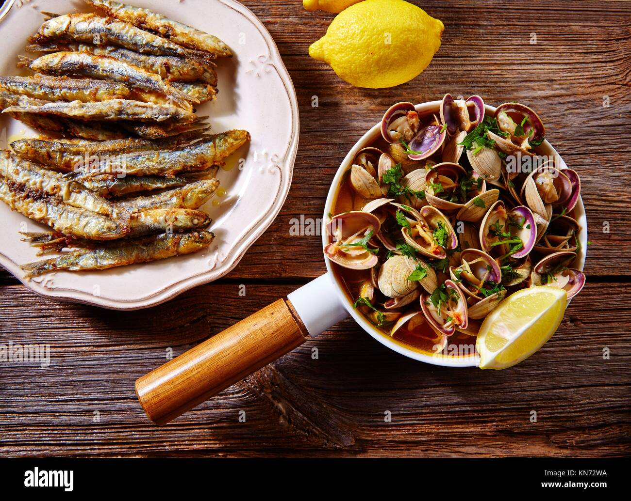 Tapas spanish seafood clams shrimps calamari romana and fried anchovies fish. - Stock Image