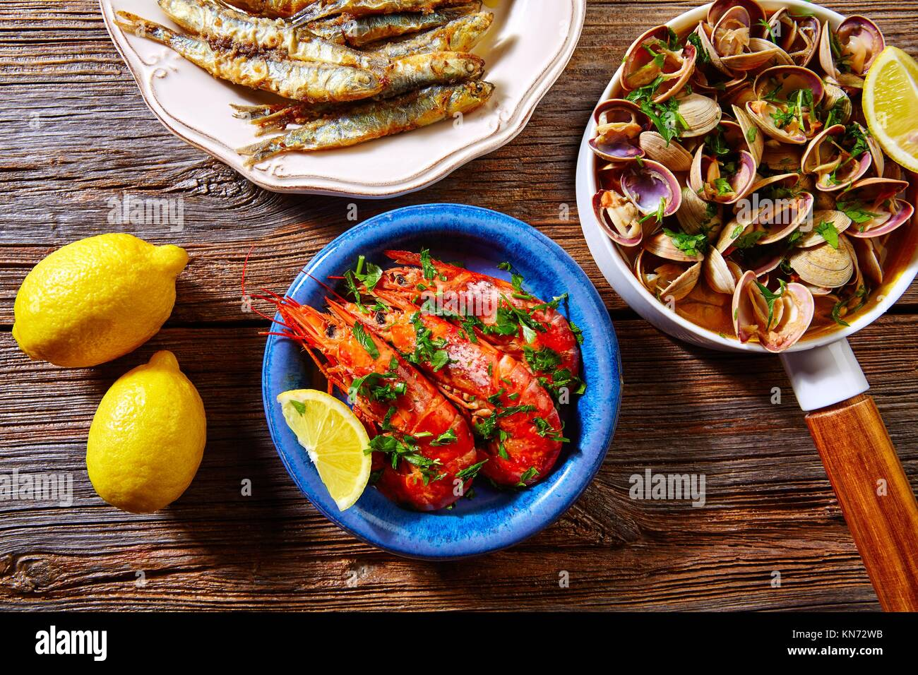 Tapas spanish seafood clams shrimps and fried anchovies fish. Stock Photo