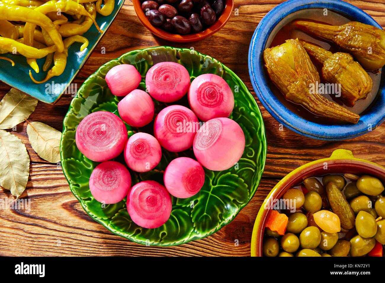 Tapas pickles mix olives chili onion eggplant from Spain. - Stock Image