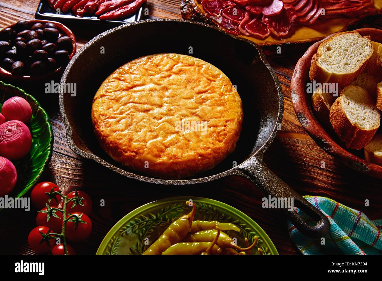 Tapas tortilla de patata potatoes omelette in a pan from Spain. - Stock Image