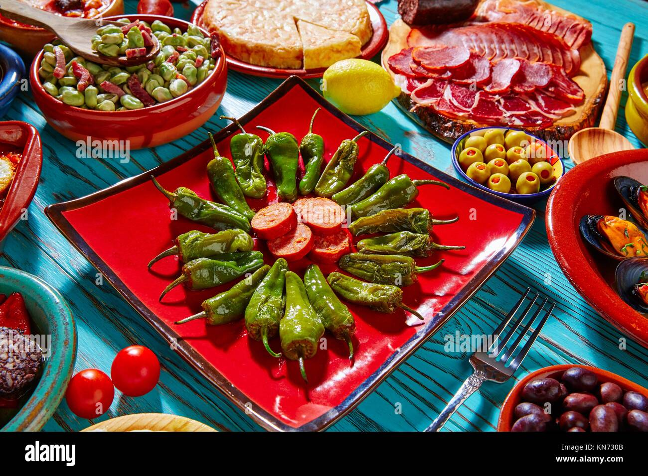 Tapas pimientos del Padron green peppers with sausage and mixed tapa. - Stock Image