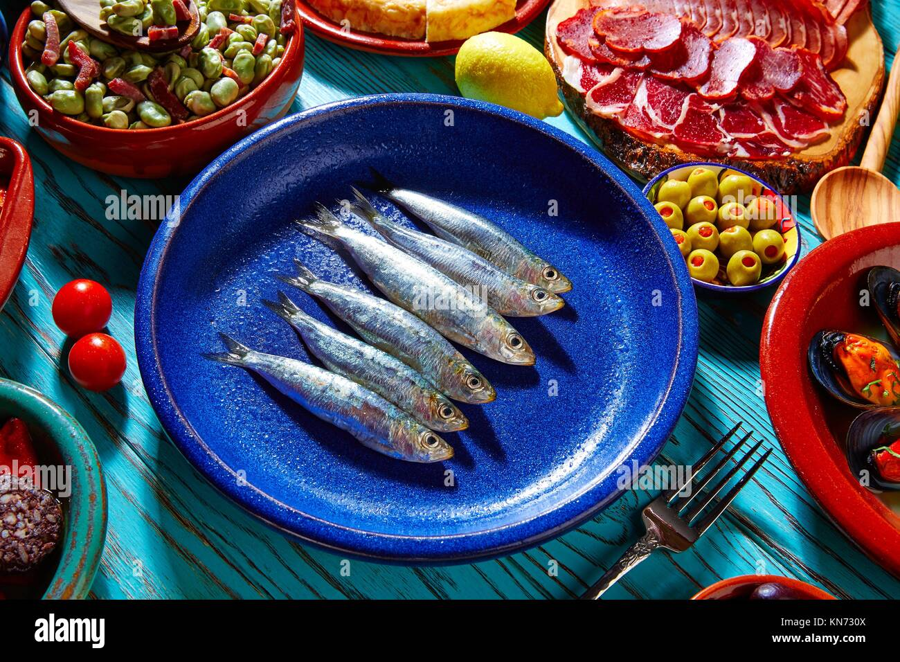 Tapas from spain sardines and mix of most popular recipes of Mediterranean. - Stock Image