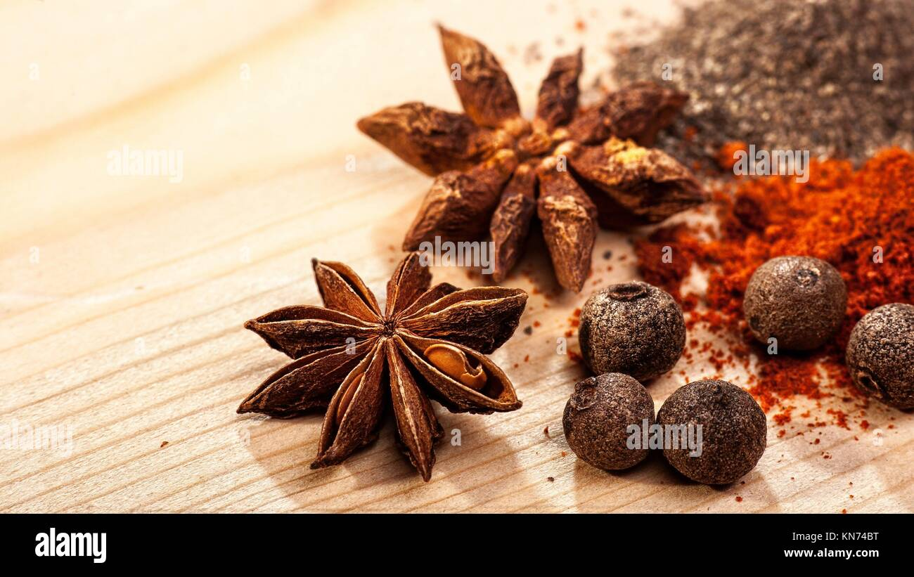 Assorted spices over wooden desk, food backgrounds. - Stock Image