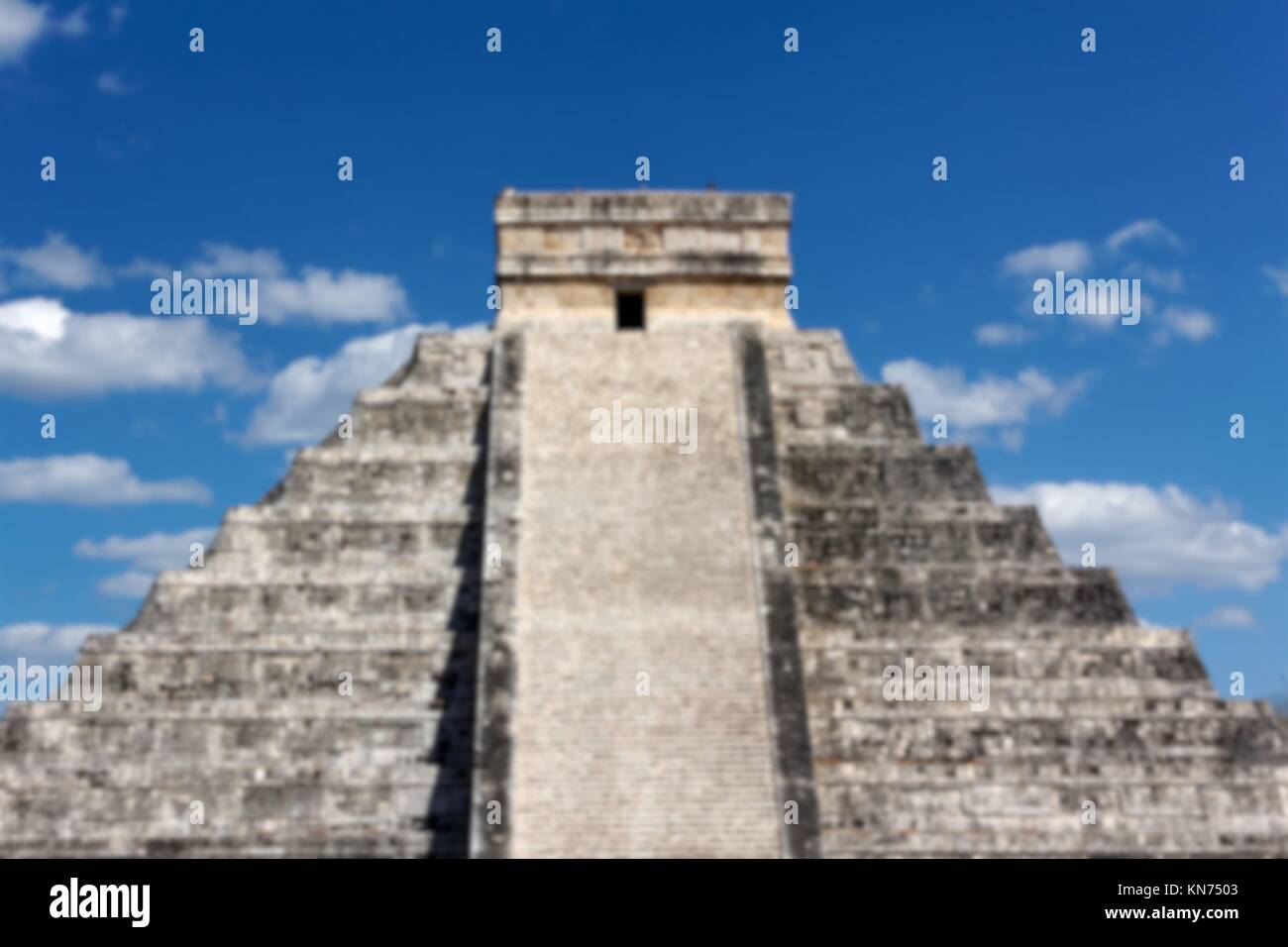 Blurred background of Mayan temple Pyramid at Chichen Itza, Yucatan, Mexico. - Stock Image