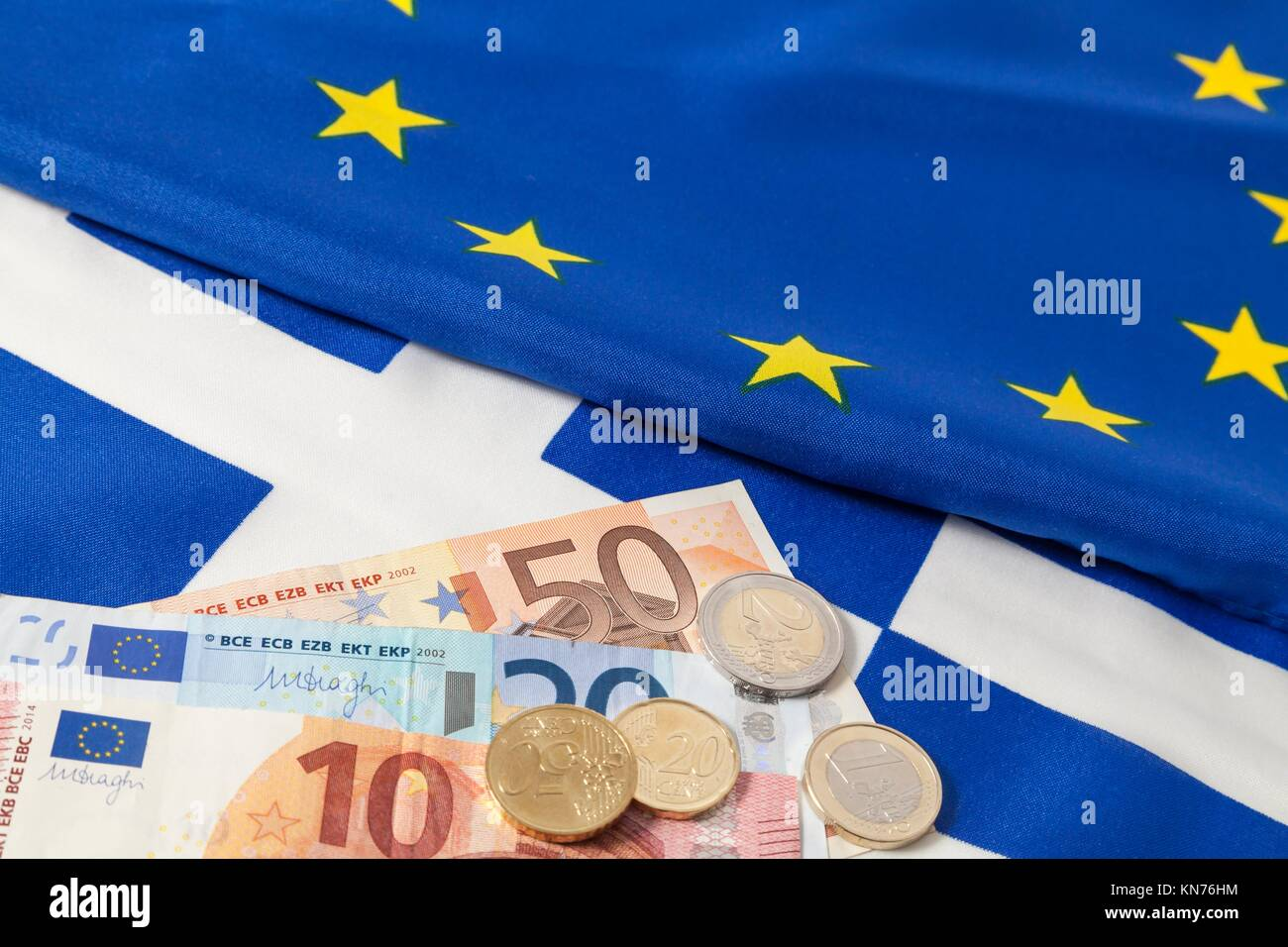 EU and greek flag and Euro cash. - Stock Image