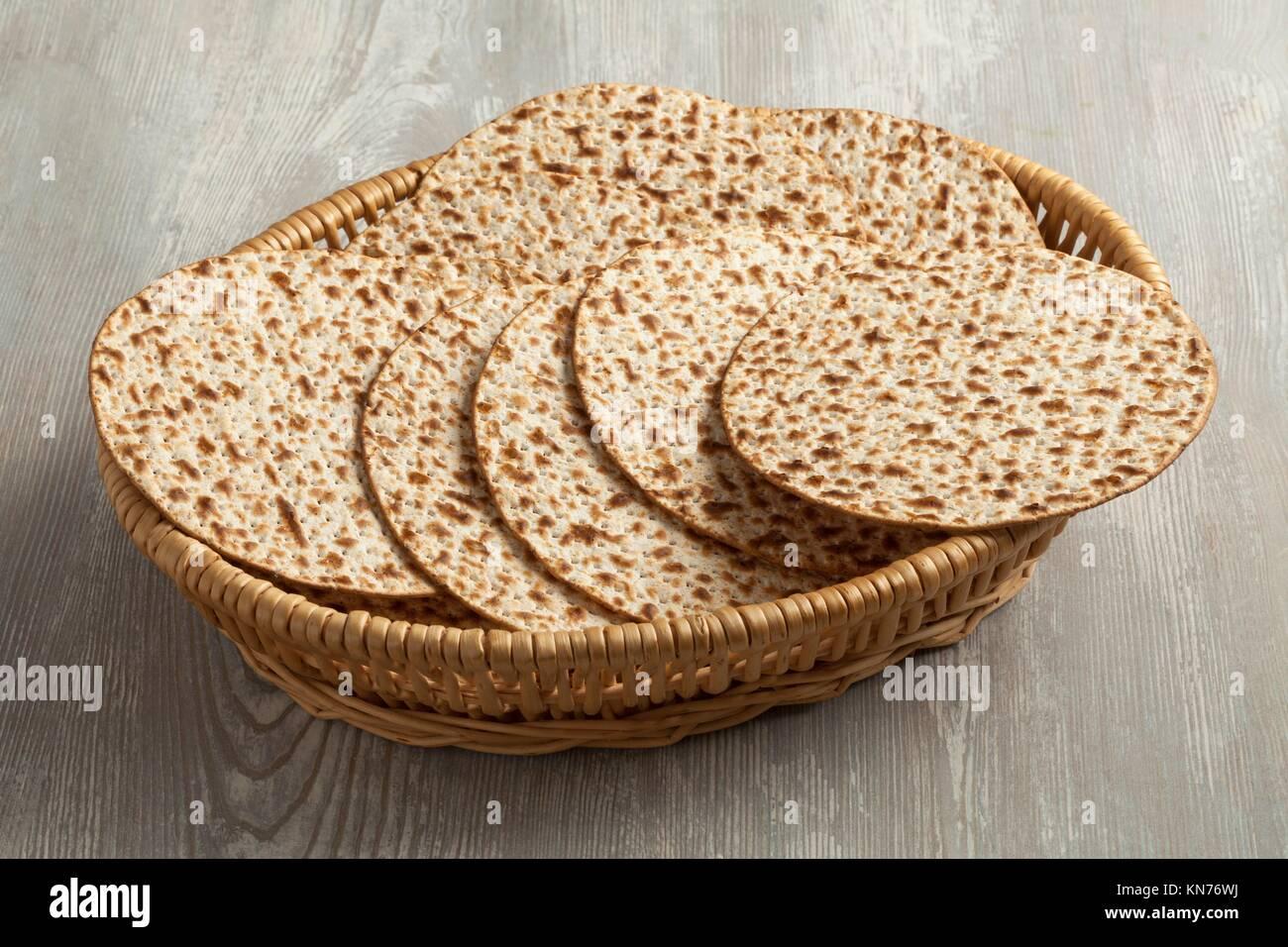Basket with fresh wholewheat matzah. - Stock Image