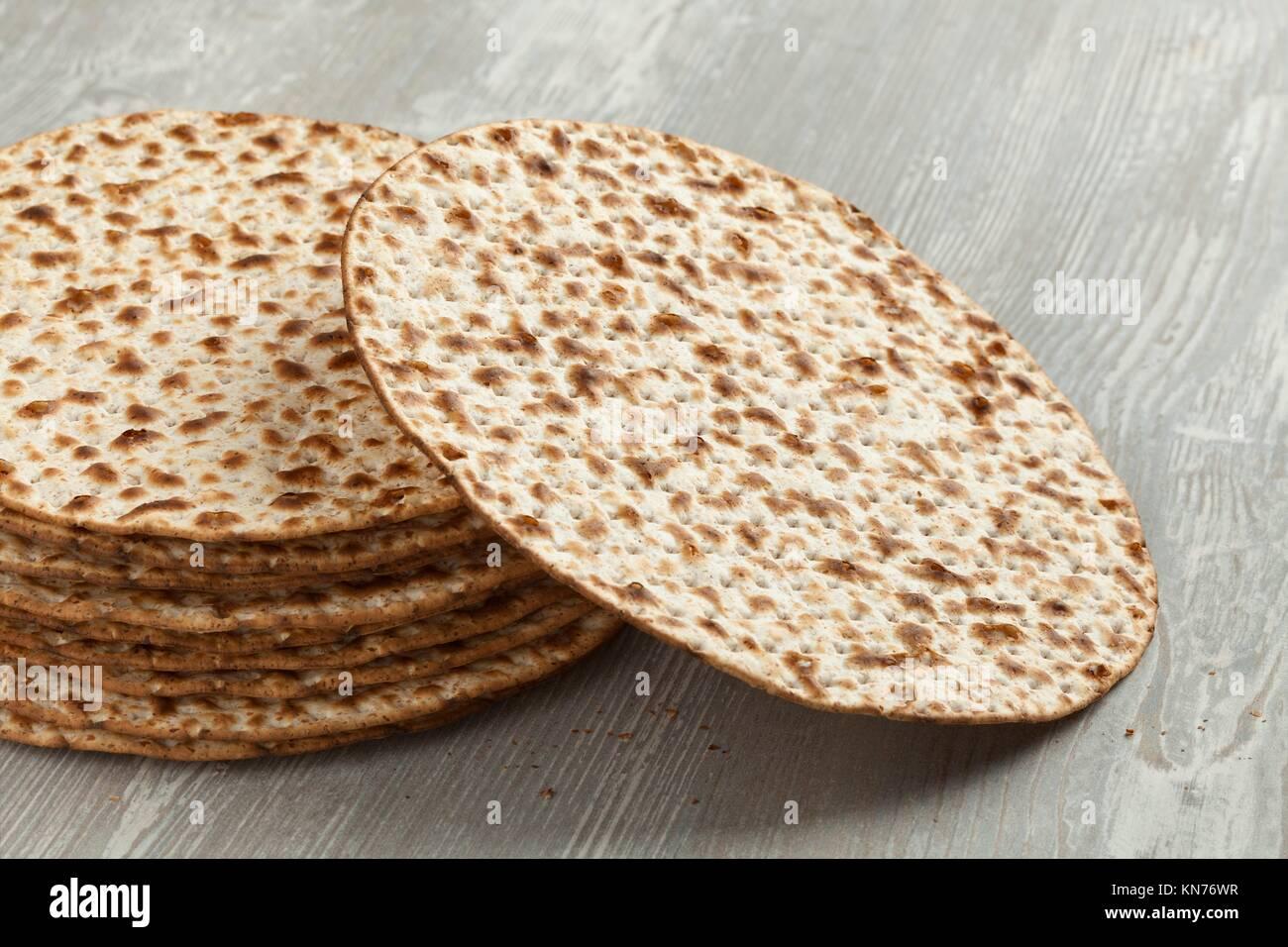 Pile of fresh wholewheat matzah close up. - Stock Image
