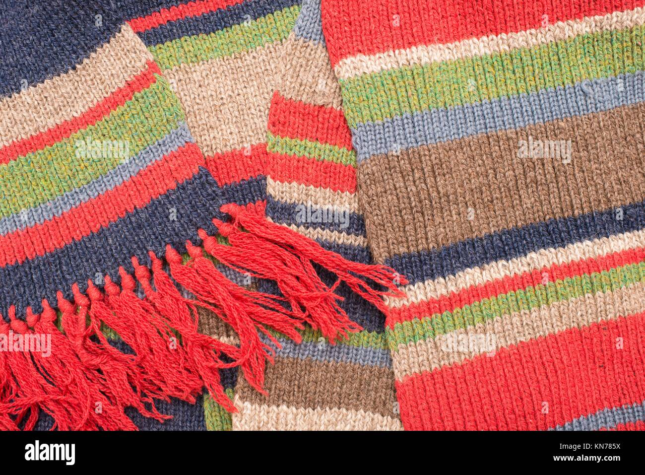 Striped wool scarf. Knitted pattern. - Stock Image