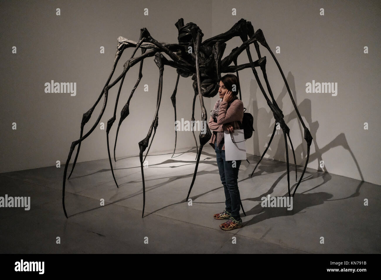 A woman studies the art work of Louise Bourgeois on display in the Tel Aviv Museum of Art. - Stock Image