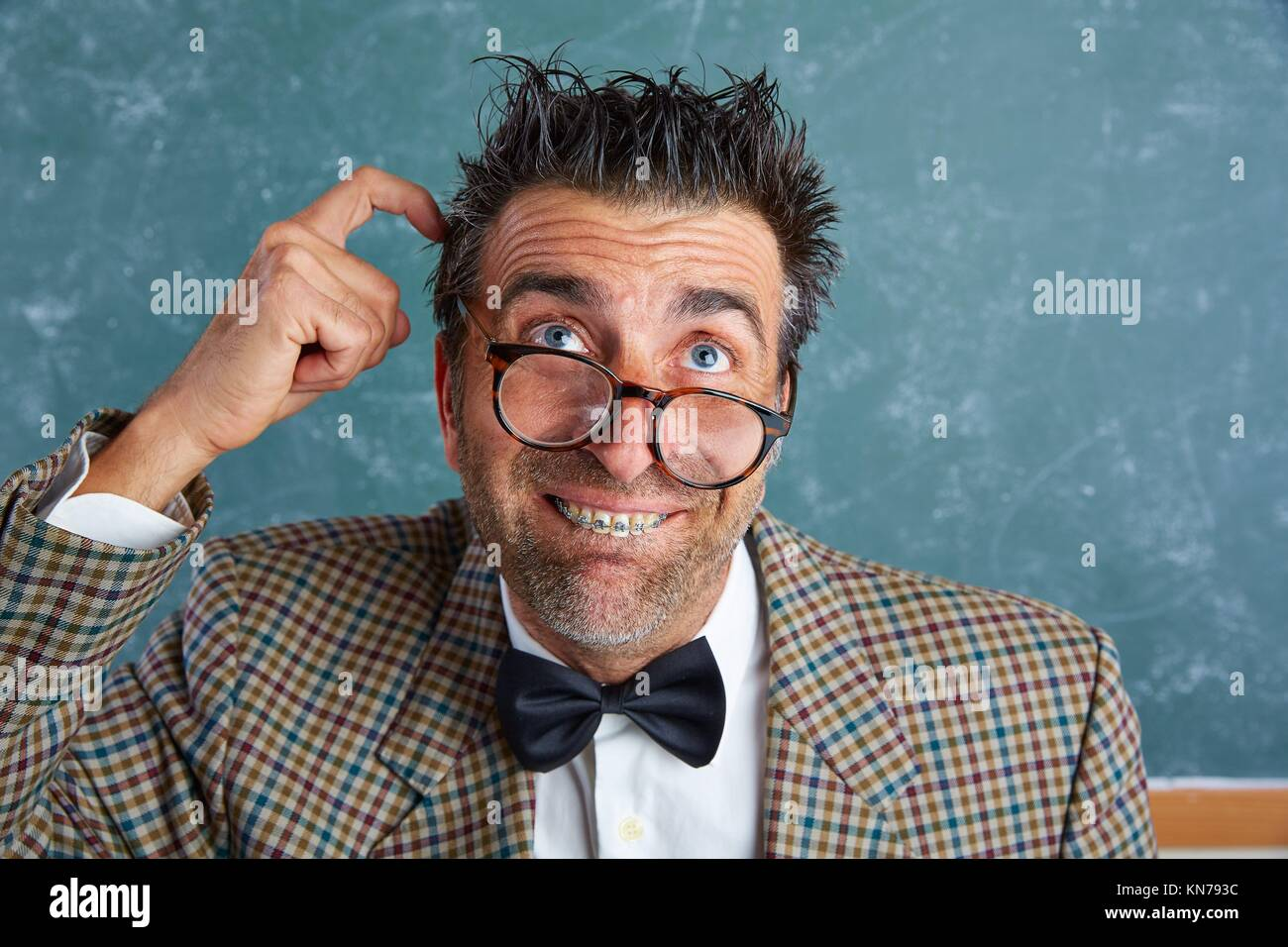 c349be72af7c Nerd silly retro teacher man with braces funny thinking doubt expression.