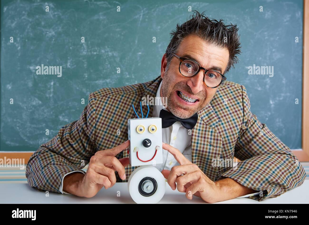 Nerd electronics technician with self made robot silly retro teacher. - Stock Image