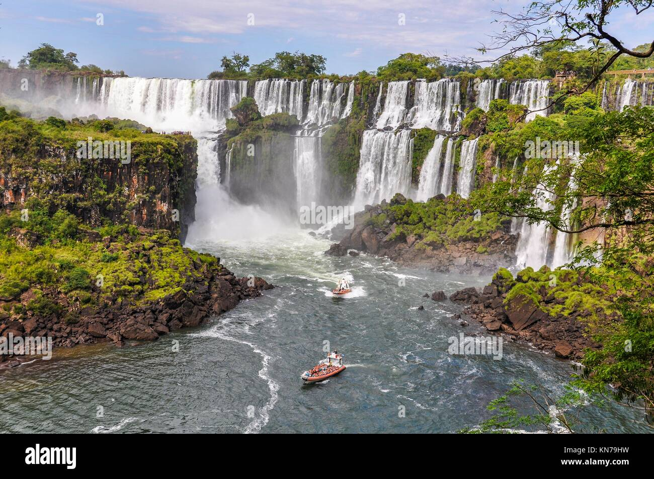 Boats around Iguazu Falls, one of the New Seven Wonders of Nature, Argentina. - Stock Image