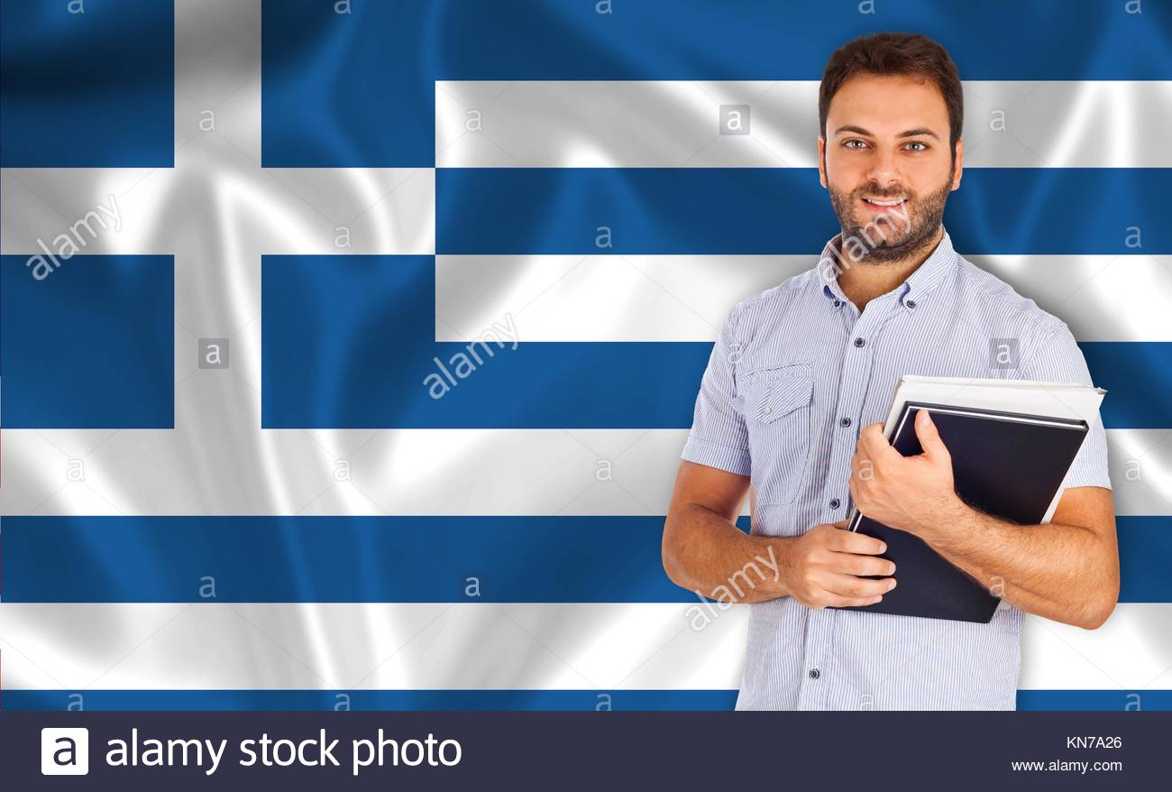 Young smiling student learns greek the language. - Stock Image