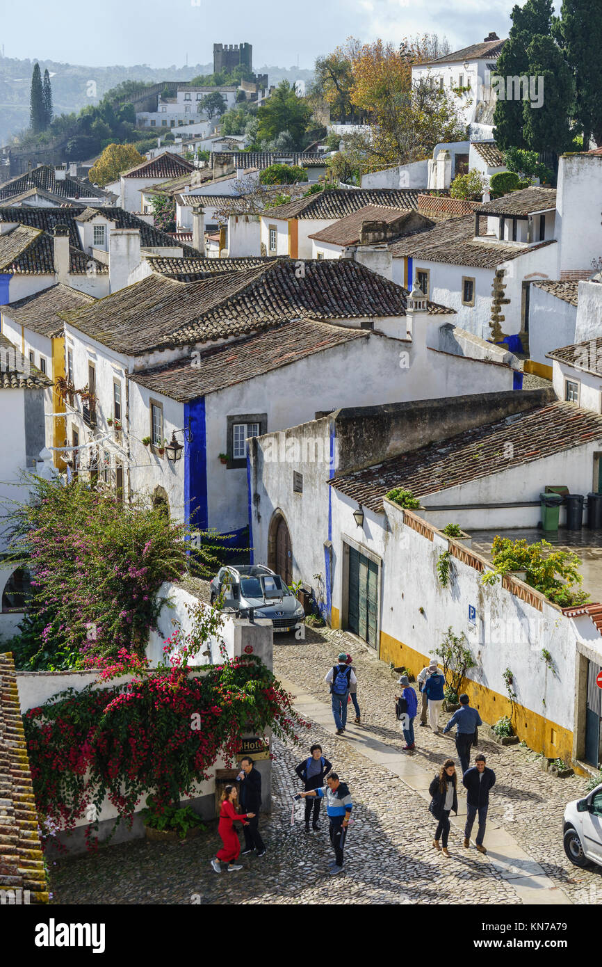Tourists in the cobbled streets of medieval Obidos Portugal November 2017 - Stock Image