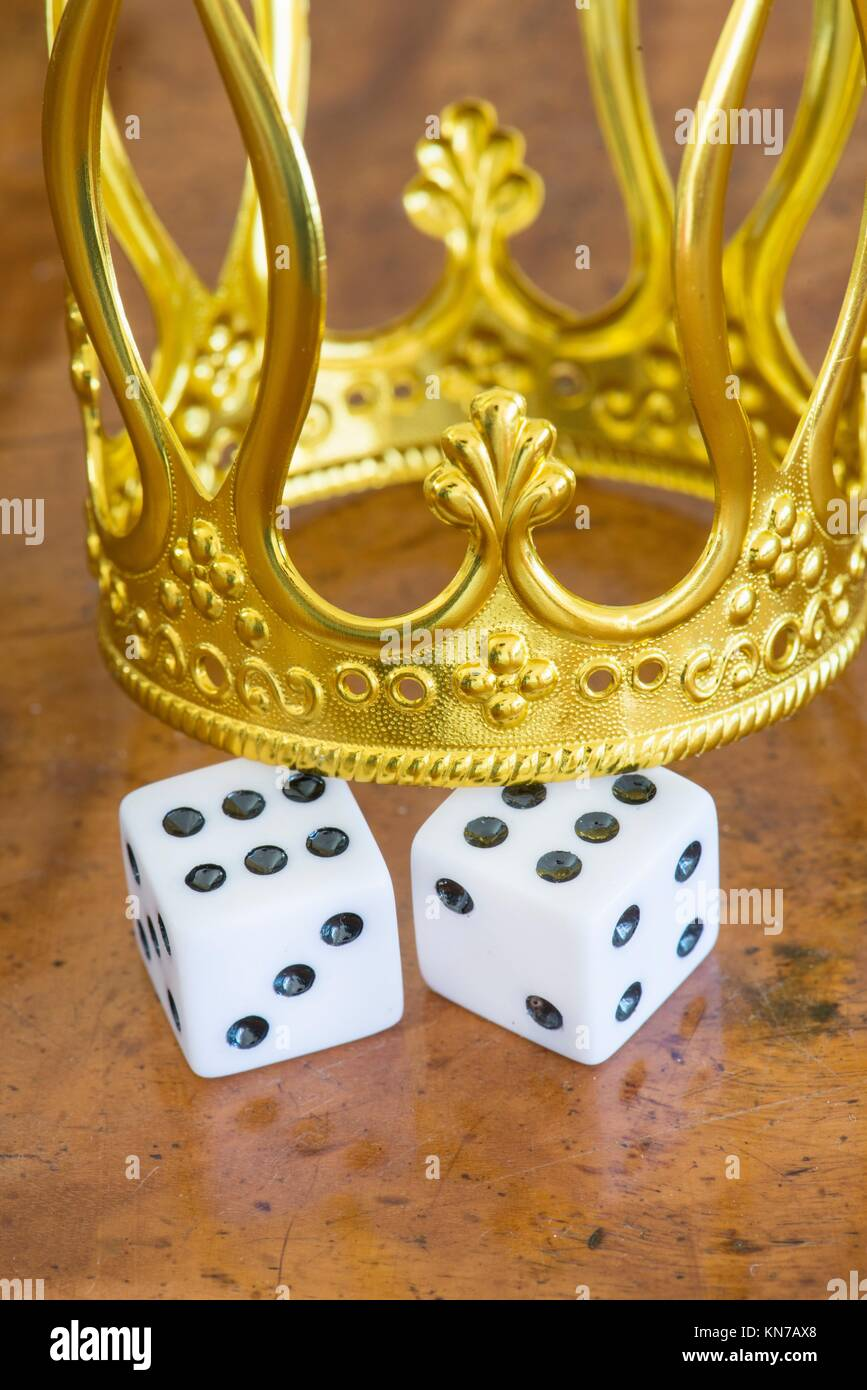 Golden crown and pair of dice. Concept of luck, success and fortune. - Stock Image