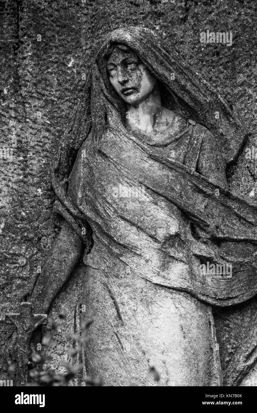 More than 100 years old statue. Cemetery located in North Italy. - Stock Image