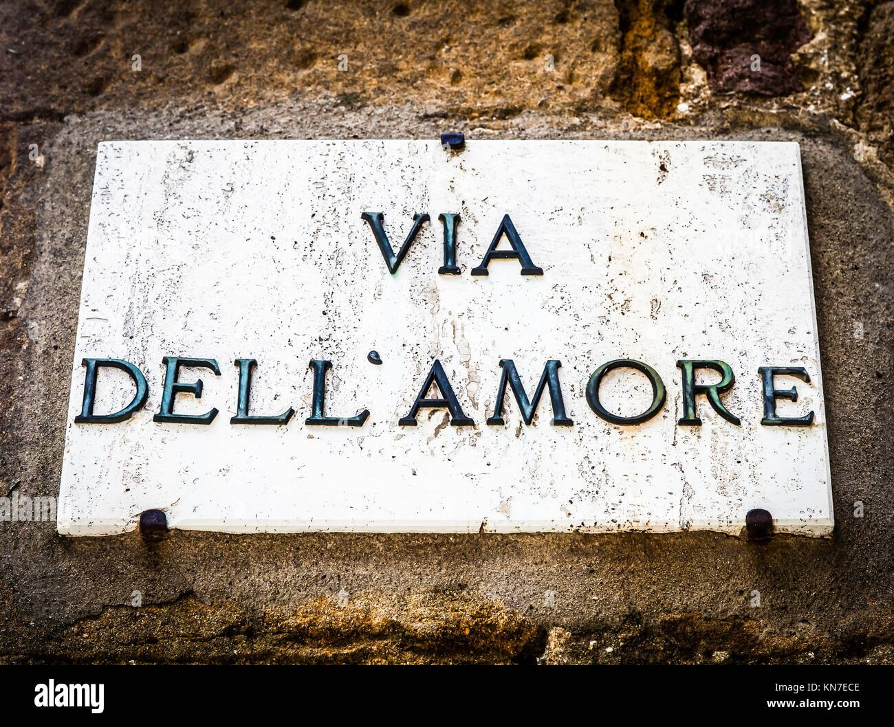 Italy - Pienza town. The streetsign of Via dell'amore (Love Street). - Stock Image