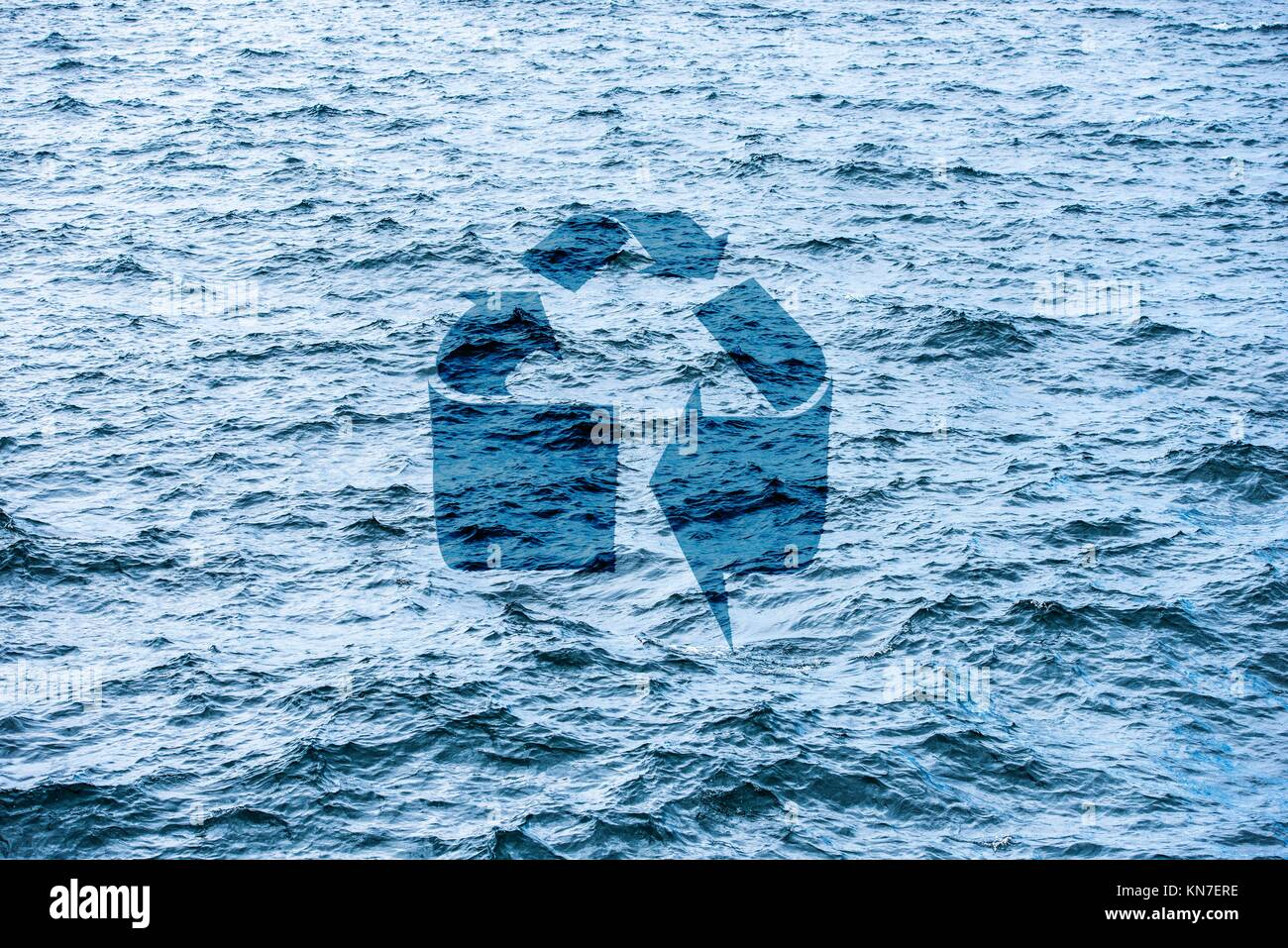 Recycle symbol on ocean surface. Concept of environment, eco awareness and saving the sea. - Stock Image