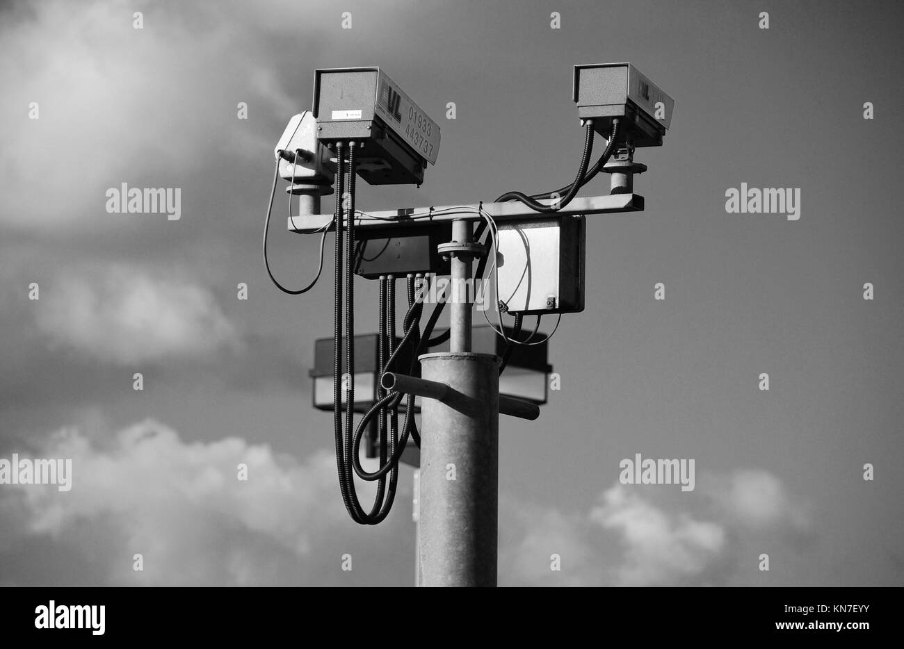 A pair of CCTV cameras on a gantry at Ashford in Kent, England on February 7, 2008. - Stock Image