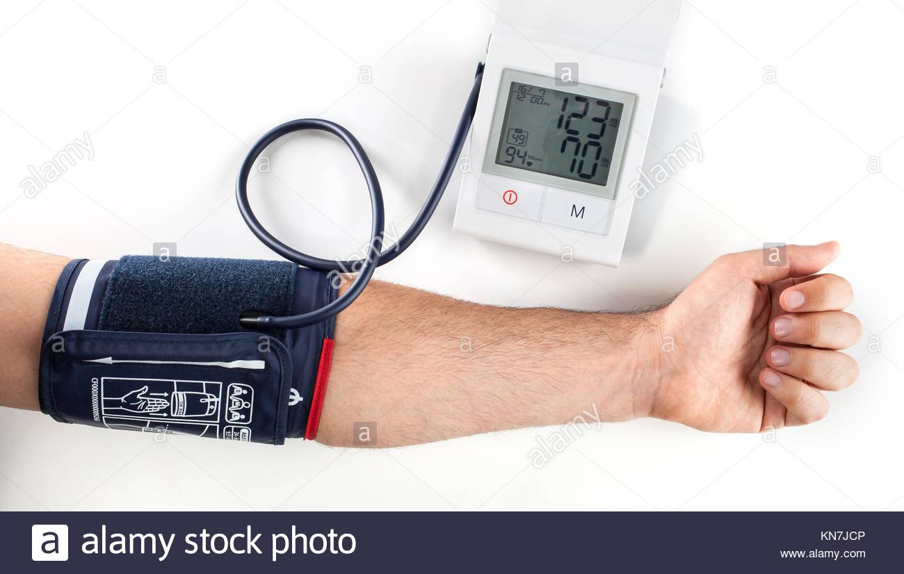 Checking the blood pressure with a modern digital equipment. - Stock Image