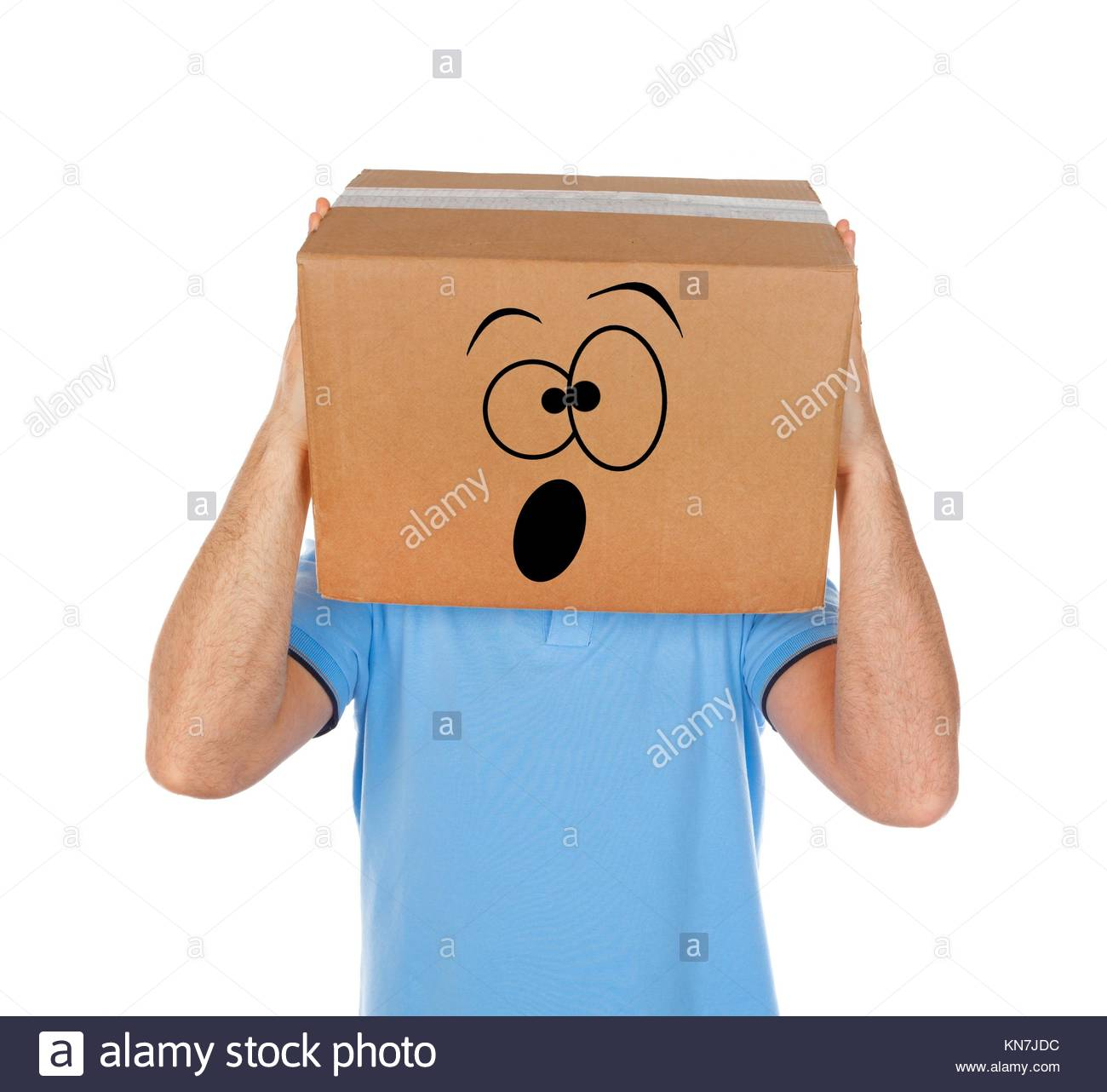 Man with cardboard box on his head and frightened emoticon face on white background. - Stock Image