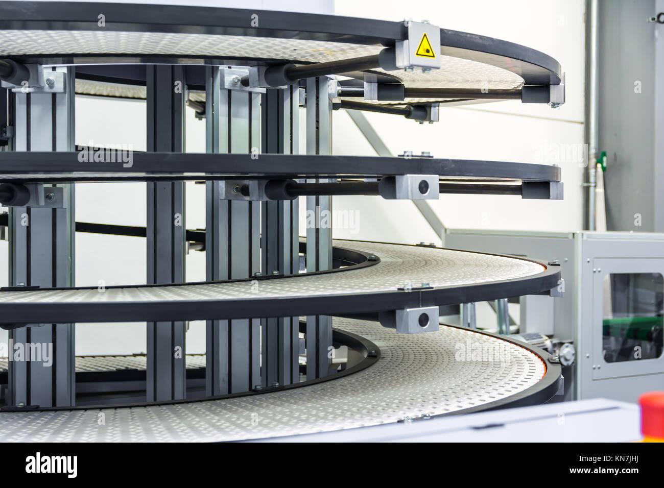 Factory Conveyor Belt Spiral Transportation Empty Idle Company Industrail Machine Book FInishing Line - Stock Image