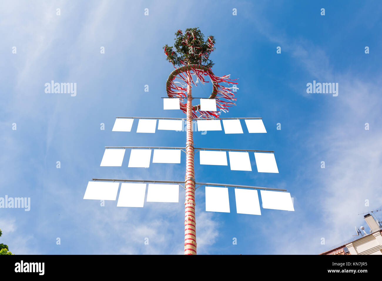 Blank White Signs on Traditional German May Pole Maibaum Blue Skies Local Tradition - Stock Image