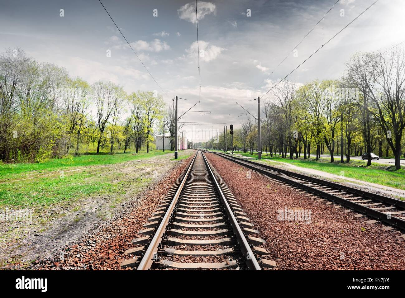 Gray cloudy sky over railroad in spring. Stock Photo