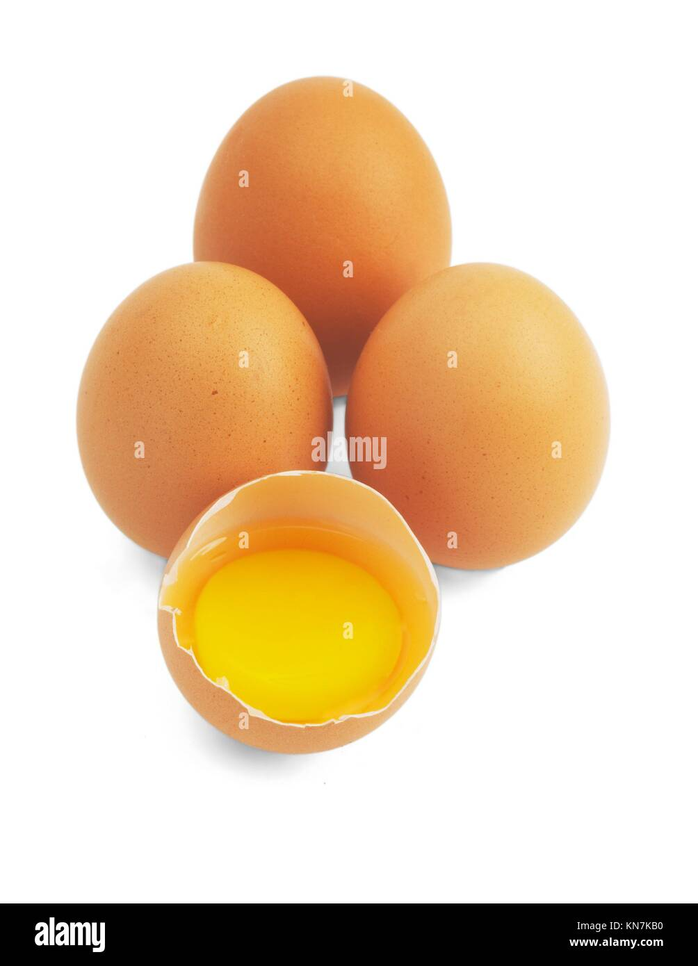 four eggs,one open ;isolated on white background. - Stock Image