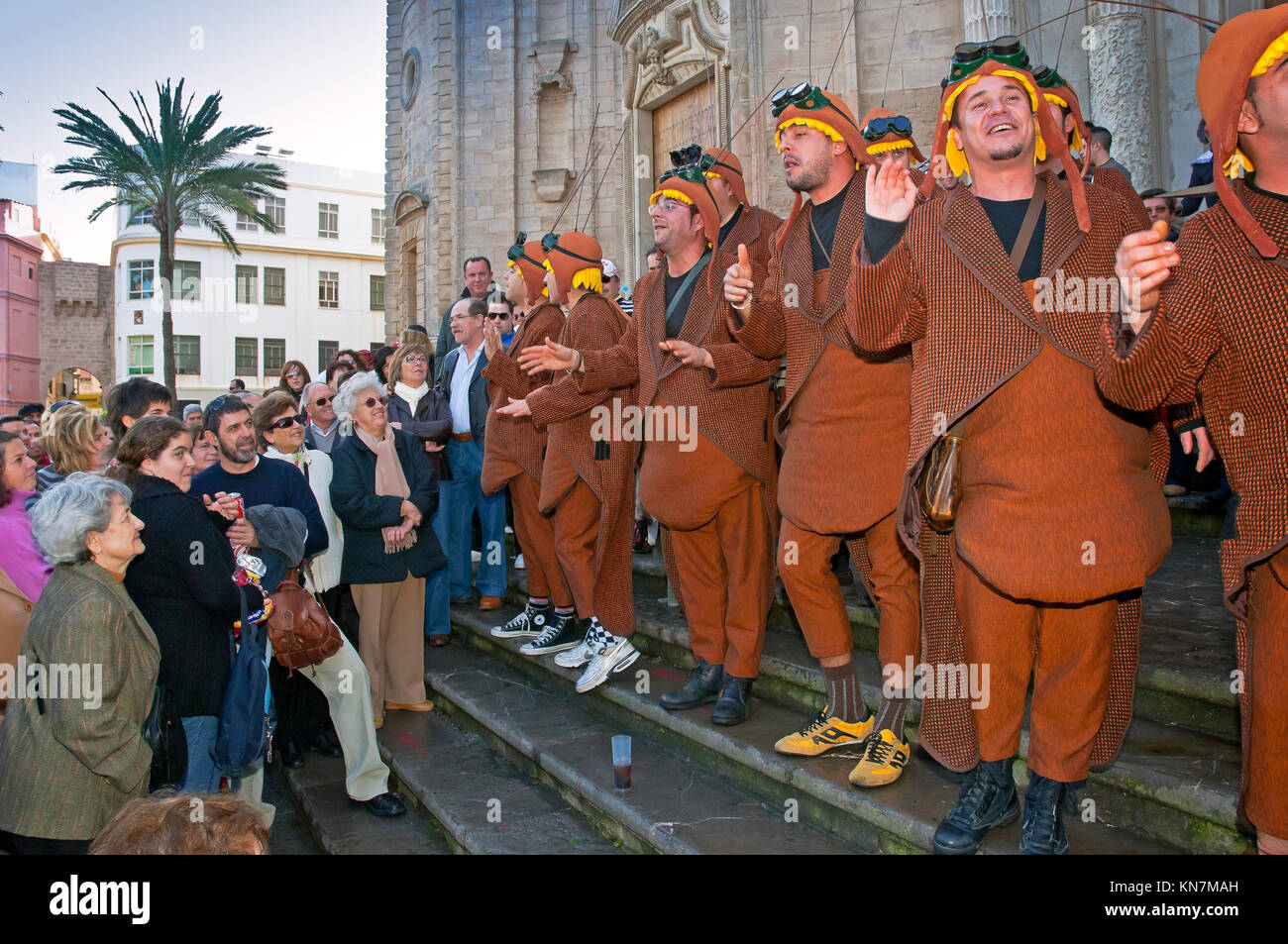 Carnival, Chirigota (musical group) singing on the stairs of the Cathedral, Cadiz, Region of Andalusia, Spain, Europe - Stock Image