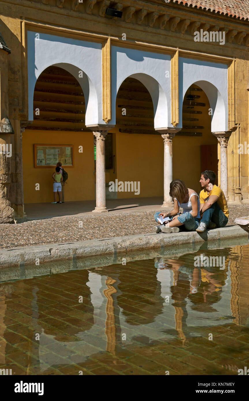 Great Mosque, Patio de los Naranjos - tourists by the pond, Cordoba, Region of Andalusia, Spain, Europe Stock Photo