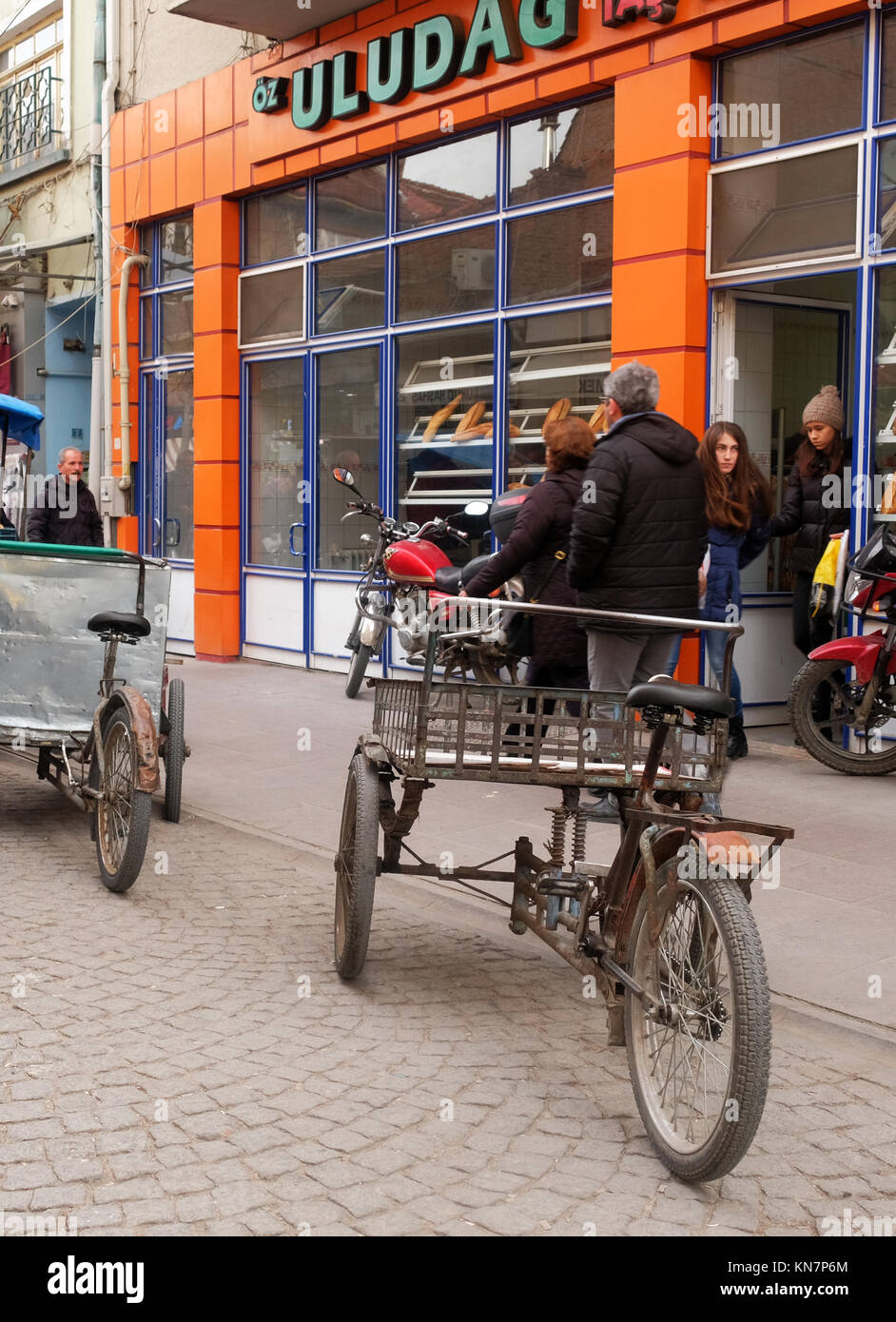 December 2017 - Tricycle cargo bikes parked in a street in Turkey Stock Photo