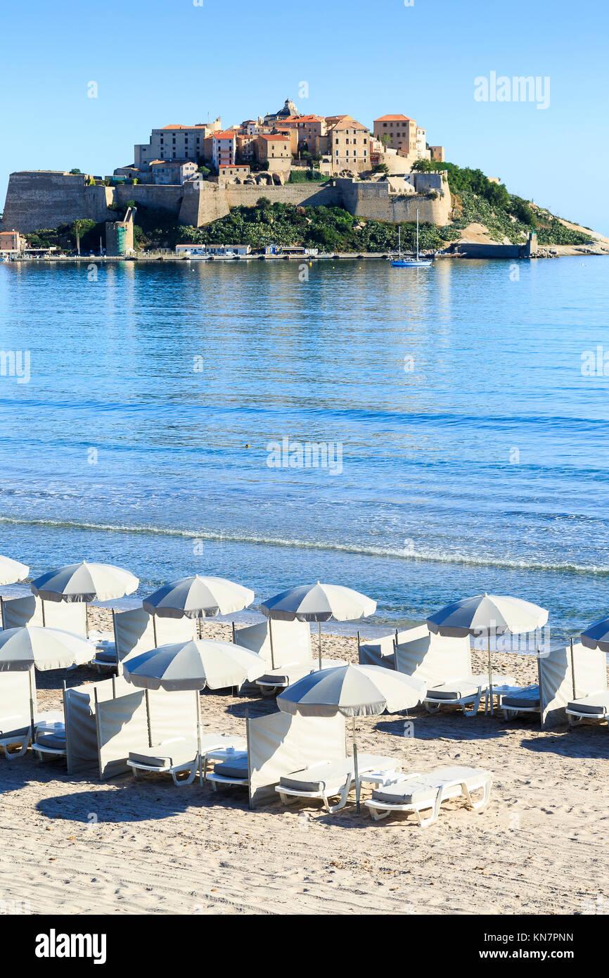Calvi Beach and Citadel of Calvi, Corsica - Stock Image