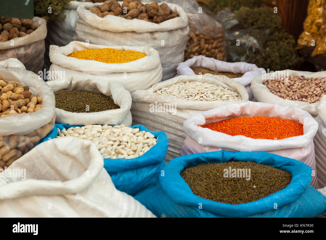 Sacks full of legumes, in an open air market in Vytina, Arcadia region, Peloponnese, Greece. - Stock Image