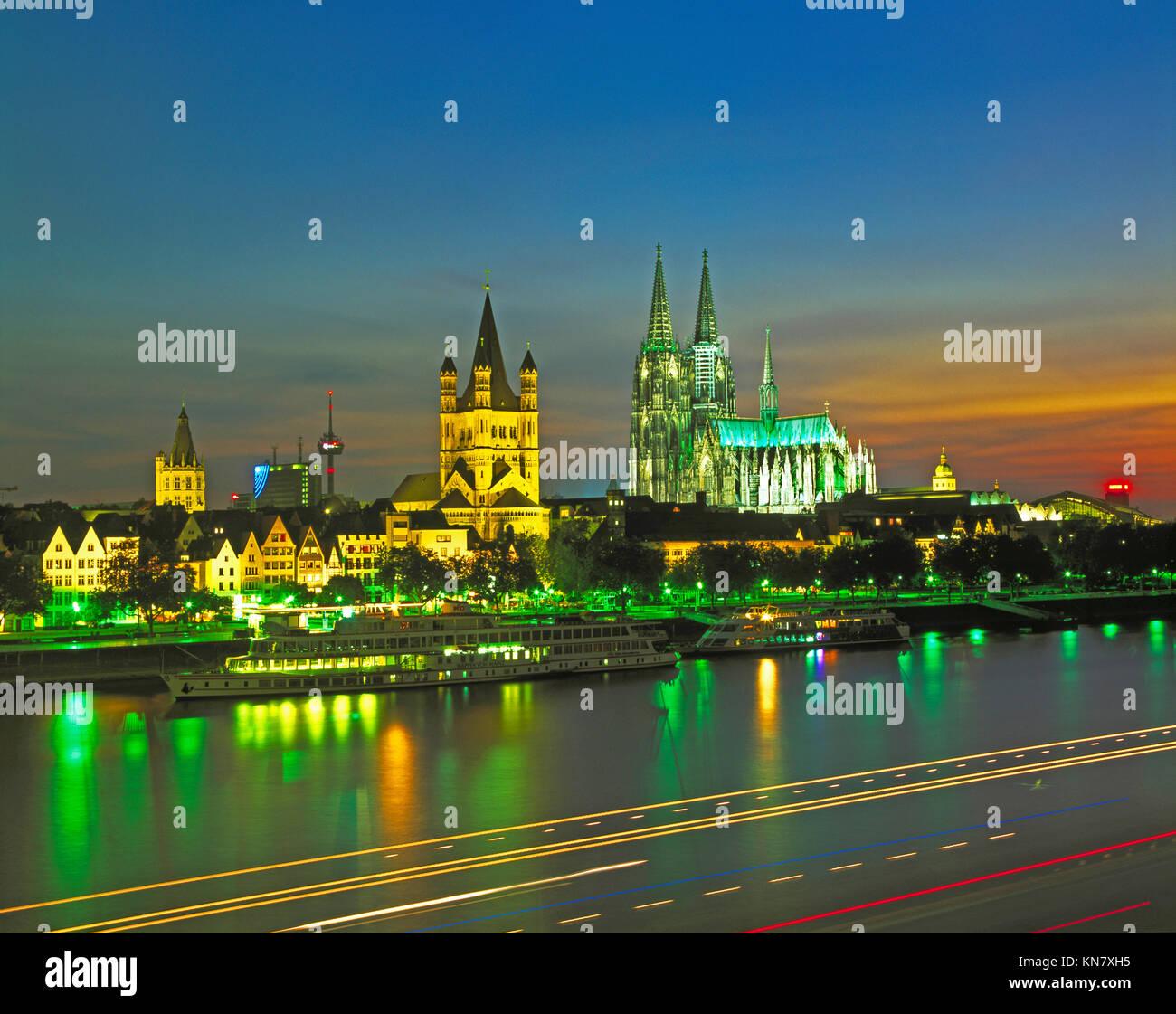 Cologne skyline and River Rhine at dusk, Westphalia, Germany - Stock Image