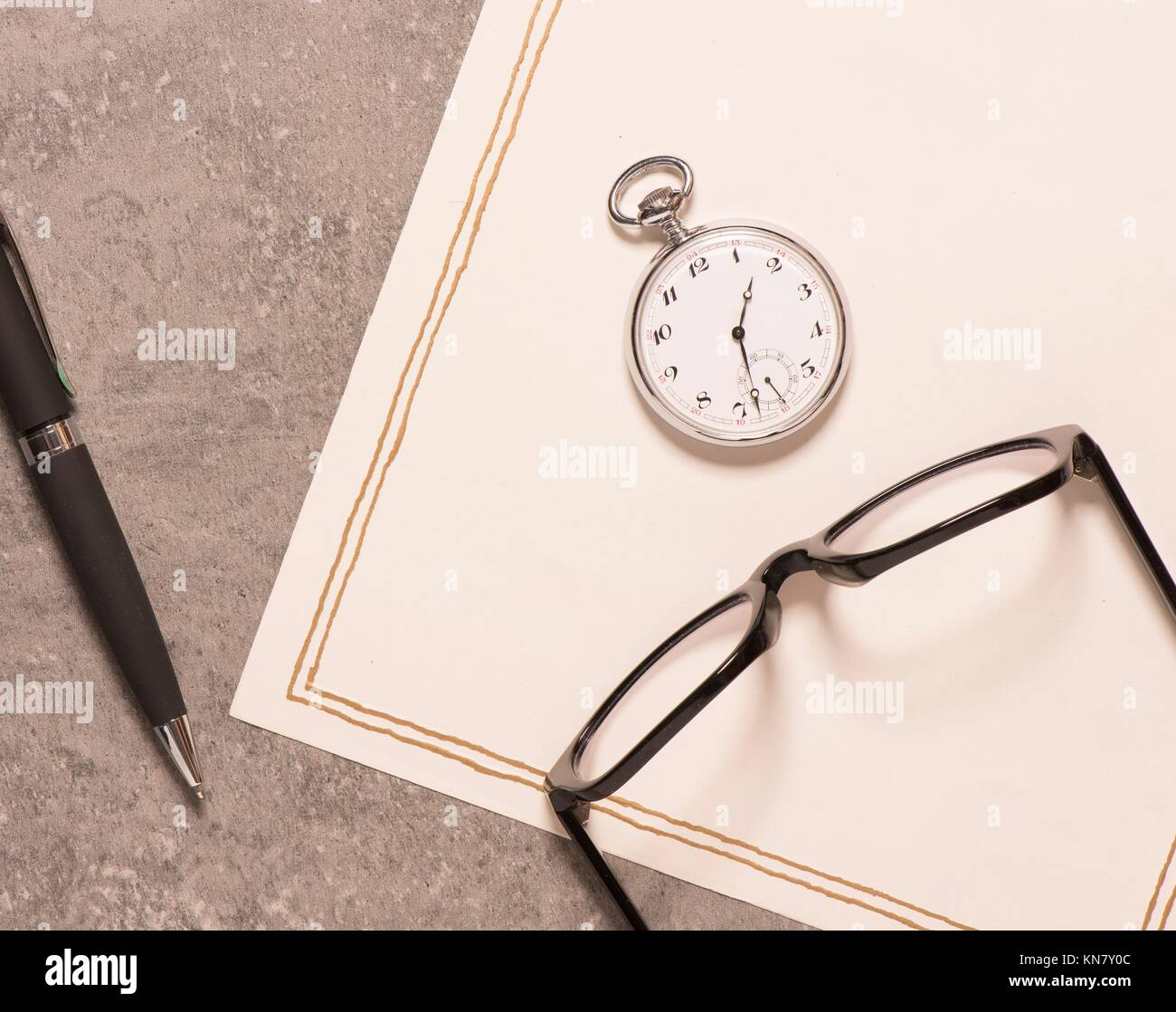 Letter paper, vintage pocket watch, glasses and pen. Concept of writing, correspondence and old fashioned communication. - Stock Image