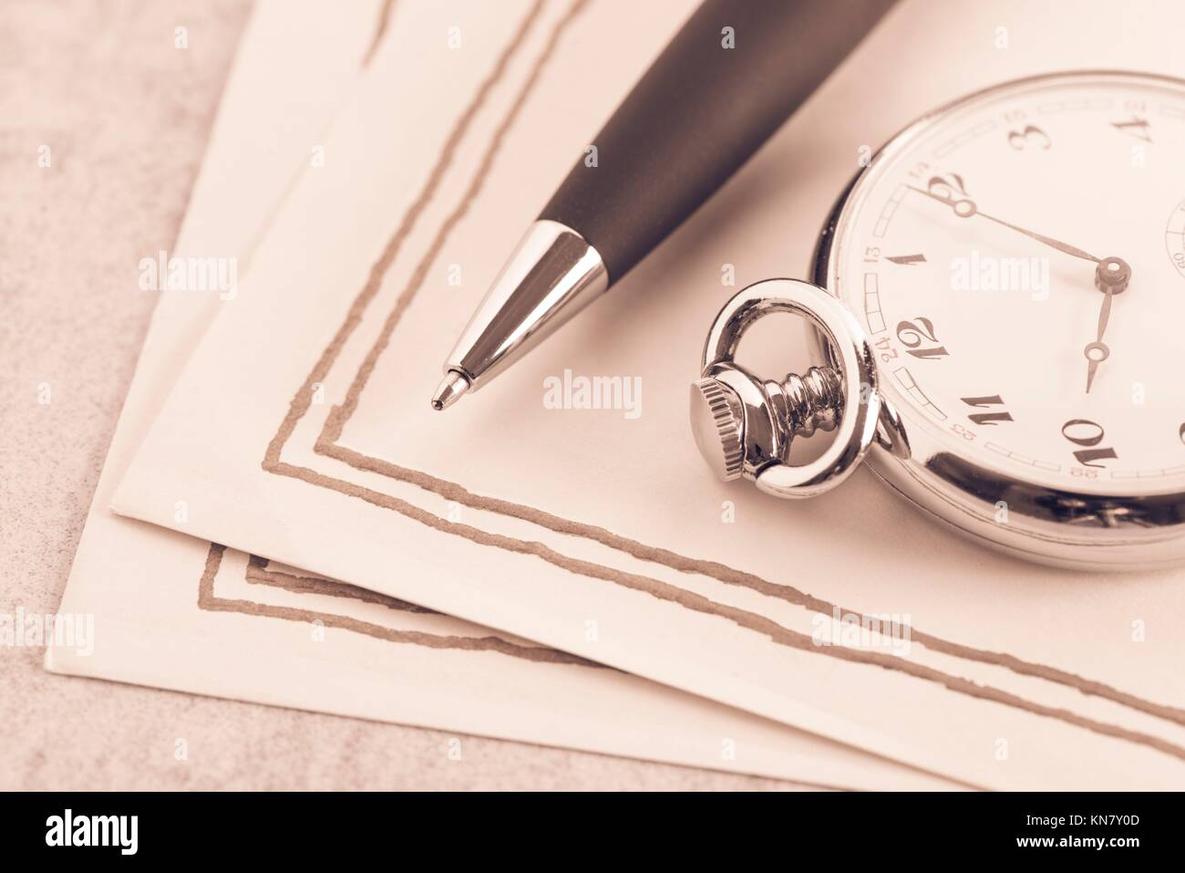 Letter paper, vintage pocket watch and pen. Concept of writing, correspondence and old fashioned communication. - Stock Image