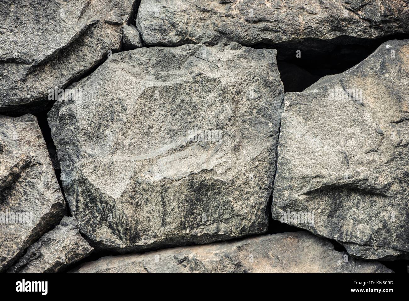 Stone background, rock wall backdrop with rough texture. Abstract, grungy and textured surface of stone material. - Stock Image