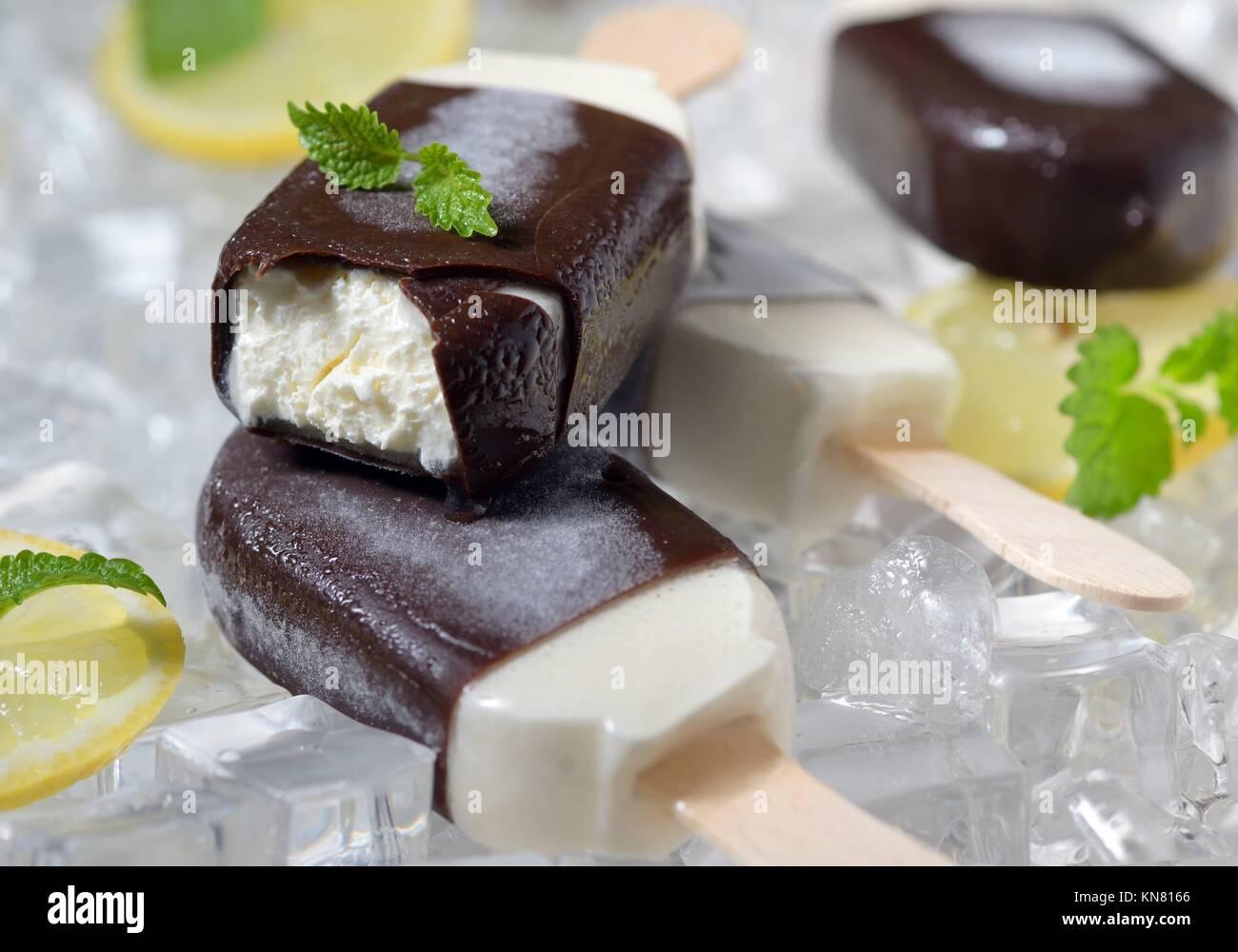 mint ice cream with lemon slices on ice cubes. - Stock Image