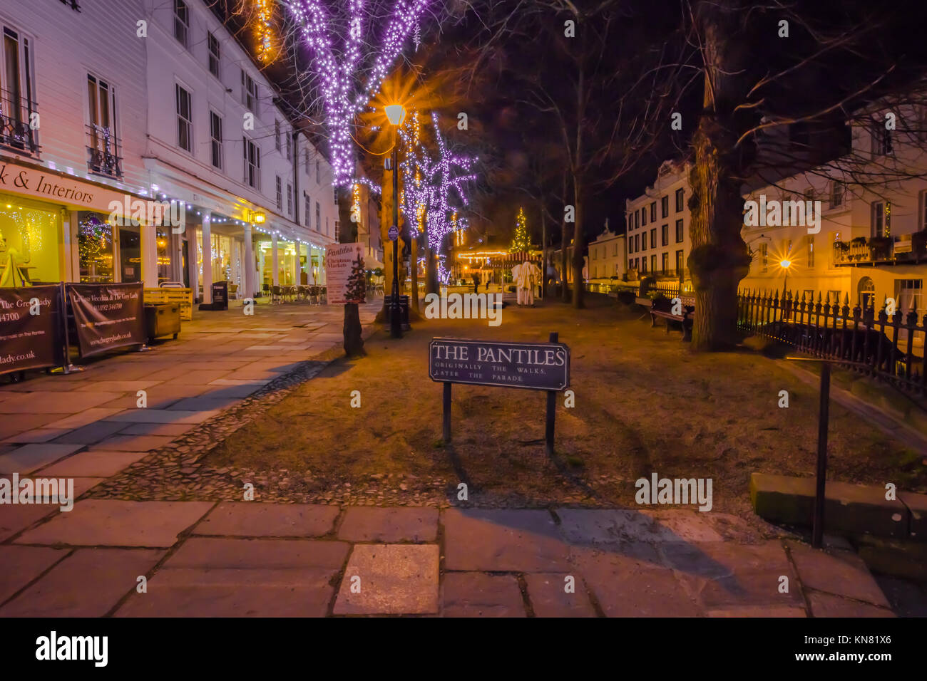 Royal Tunbridge Wells The Pantiles pedestrianised colonnade Dusk evening dark with shop lights and Christmas lights - Stock Image